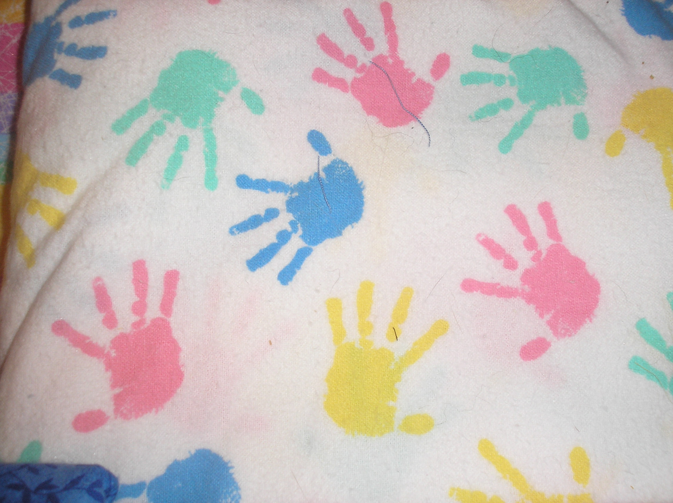 Pastel hand-prints on white background