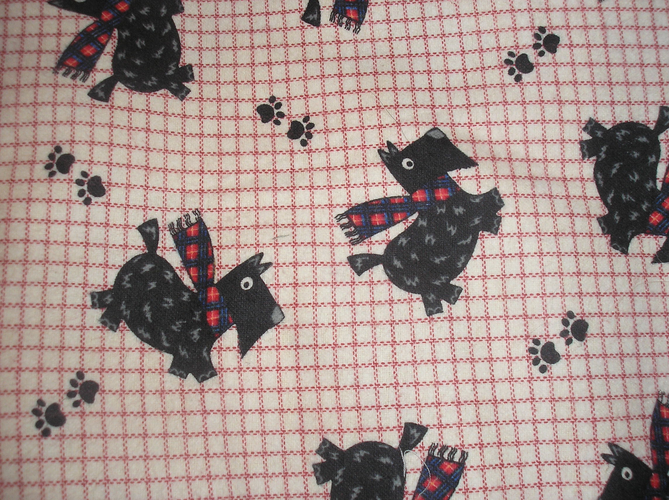 Scotties on white background available with blue or red lines in design.